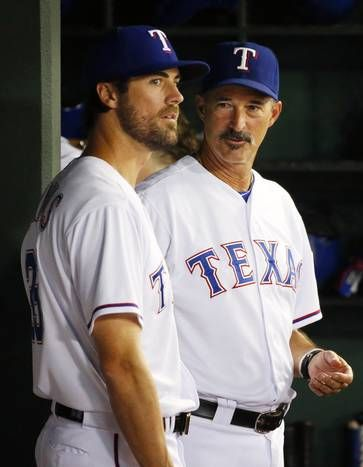 Texas Rangers pitcher Cole Hamels (35) talks with Texas Rangers pitching coach Mike Maddux (31 in the dugout at Globe Life Ballpark in Arlington, Texas on Friday, July, 31, 2015. The Rangers acquired Hamels and Jake Diekman from the Philadelphia Phillies for 5 prospects and pitcher Matt Harrison. (Michael Reaves/The Dallas Morning News)