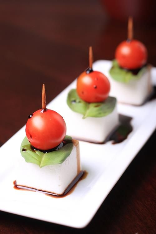 Mini Caprese Bites - could use mini mozzarella pearls, but these square ones stand upright
