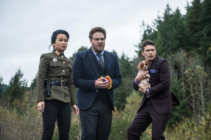 Diana Bang with Dave (James Franco) and Aaron (Seth Rogen) in The Interview