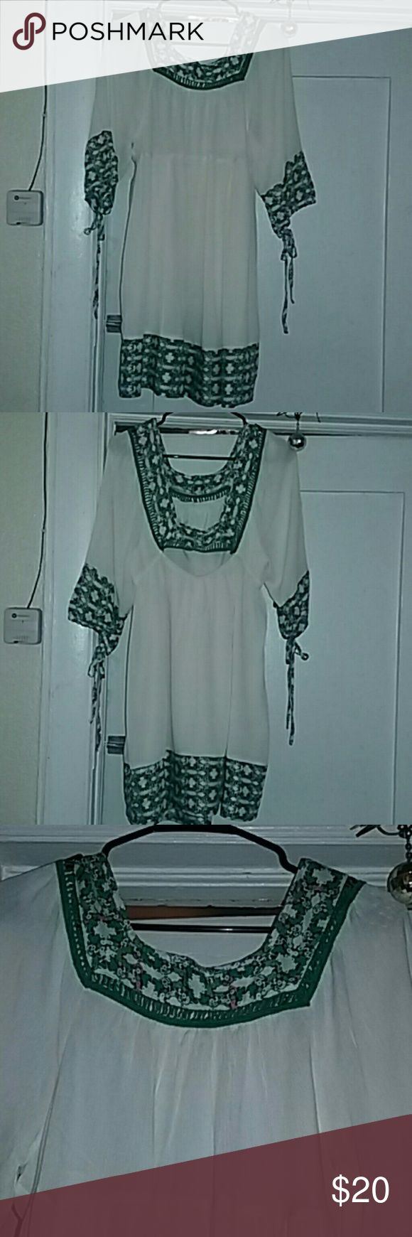 Esley Boho Dress This gorgeous dress has a square front neckline, back also has a deep square neckline with a middle slit opening which has elastic gathering. Front neckline, sleeves end, and hemline all are trimmed in a mult-pattern green, orange cross type design, very pretty. 3/4 sleeves have a tie at the end, neckline has a green crochet trimming,  dress has two inner side pockets, fully lined. This dress is made of rayon, cotton and spandex. Size Medium Color is cream,  green and…