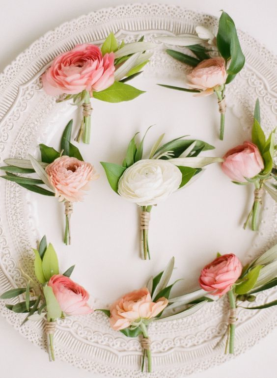 These boutonnieres speak for themselves. There is no need for anything additional to fill out these arrangements. The ranunculus bloom is full and exceptionally elegant and will complement other styles of floral arrangements you choose.