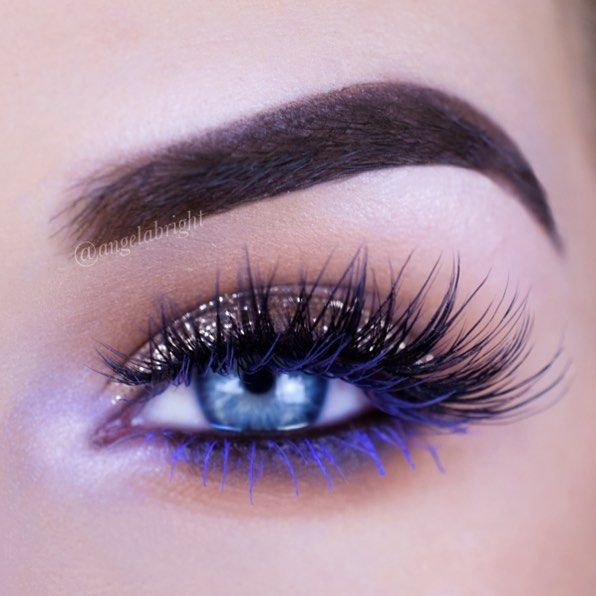 glitter shadow with bright pop of color on the bottom lashes!