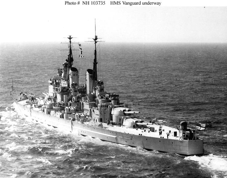 "HMS Vanguard(23) showing her distinctive transom stern. The Royal Navy's last battleship, HMS Vanguard, shown shortly after commissioning in 1946. Laid down as a 'one off' early in WW2 to make use of stored 15 in guns, her completion was delayed till after the war by higher resource priorities.Built by John brown & Co, Clydebank. 44,500t standard load,814ft long.4 Shafts powered by 4 Parson Steam Turbines gave 30kn. 4 x 2 15"" & 8 X 2 5.1/4"" QF guns. She remained in commission till 1960."