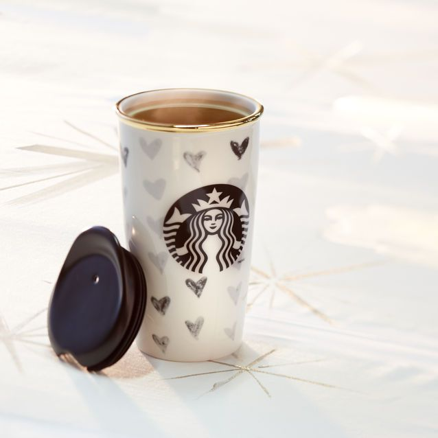 Starbucks A double-walled ceramic mug with a black heart design. Part of our Dot Collection.