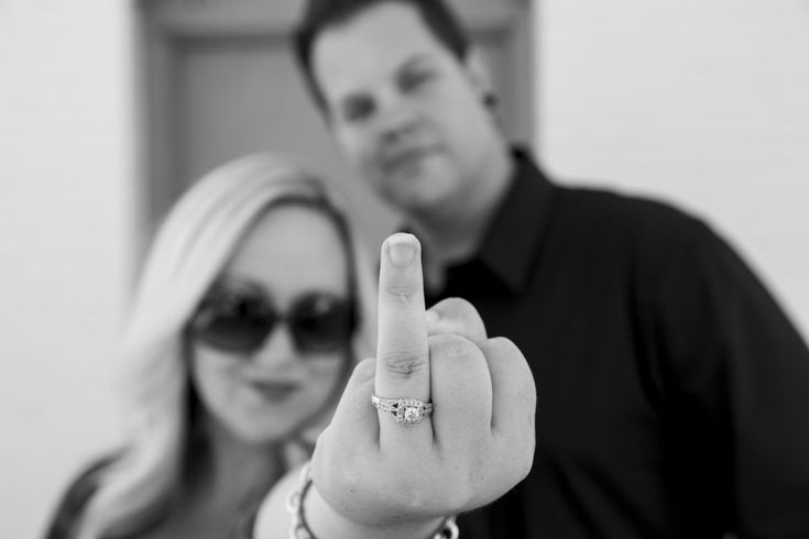 Love this, funny way to show off the ring. It would be better if they were back to back with glasses and both looked mad