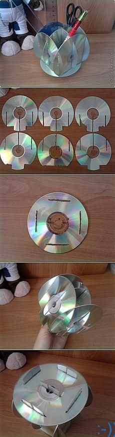 Here is another idea for recycling your old DVDs. You can use a few of them to make a pencil holder. You need seven DVDs in total. Cut them as shown in the tutorial. Stick the DVDs together, and you have a pencil holder that will declutter your desk. source : pinterest