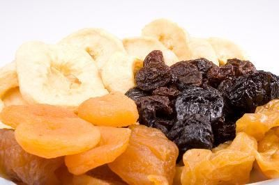 Prunes and dried apricots are excellent sources of dietary fiber. They're especially rich in soluble fiber, the type that dissolves into a gel-like substance and binds to fatty acids to encourage their excretion in waste. This is the quality that gives soluble fiber its ability to reduce high LDL and total cholesterol levels.
