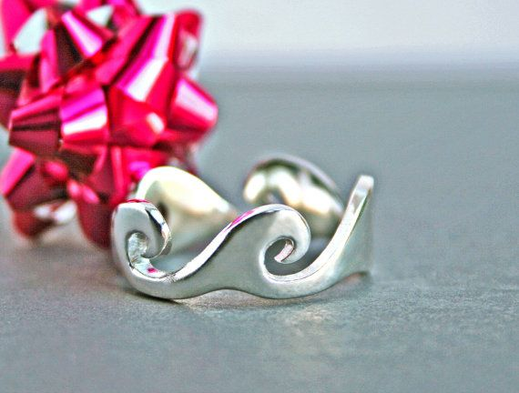 Ocean Wave Ring...this solid sterling silver Wave Ring captures the beauty of ocean waves; rolling sets of waves encircle the entire band. Ive taken