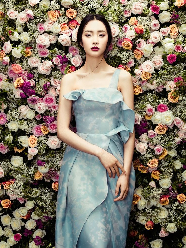 Kwak Ji Young models all looks from Phuong My's spring-summer 2015 collection. A dress in blue features feminine ruffles