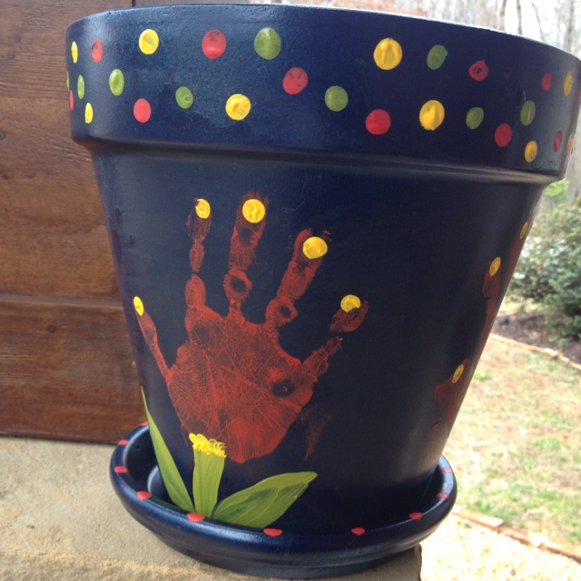 My toddler's handprint flower pot :) pinned by someone else. Very cute for mother day