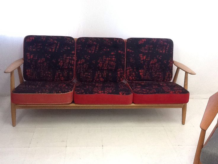 A lovely oak #sofa designed by #danish #master Hans #wegner for #getama in 1955. All original sprung #cushions with the two-tone red or black/red covers and buttons.  A lovy sofa for your #modern #scandinavian #interiors  £2350 available now  http://bit.ly/1IXTKNE