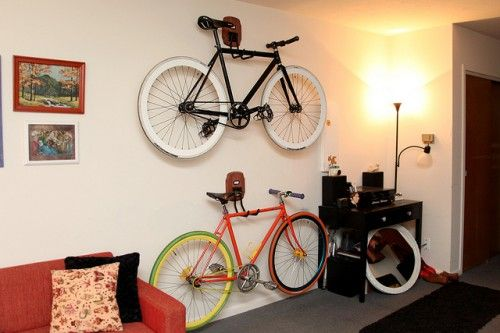 DIY Bike Wall Storage Racks   Shelterness -- i love the his/her labels!  the original instructions were unpinnable, so follow the link on this page to mini penny.
