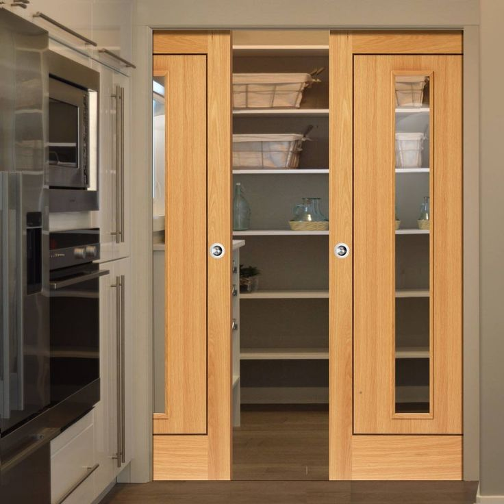 Double Pocket Roma Spencer Oak sliding door system in three size widths with clear glass. #pocketdoors #contemporarydoors #oakglazedpocketdoors