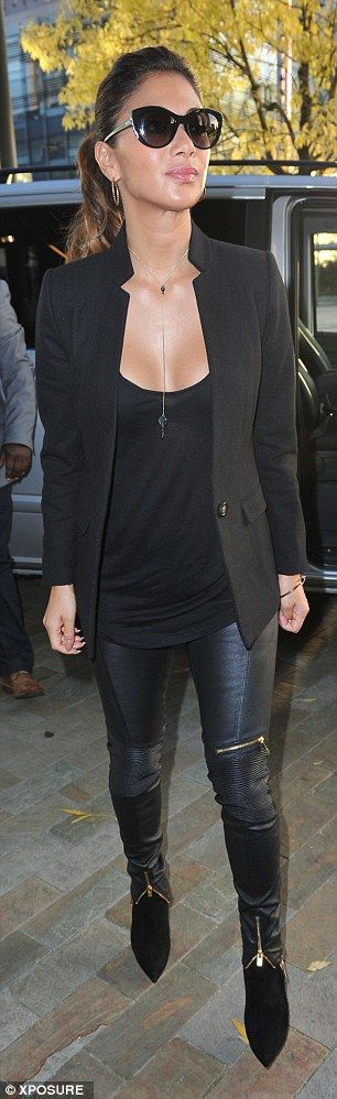 City chic: She added height to her slender frame with black suede leather boots...