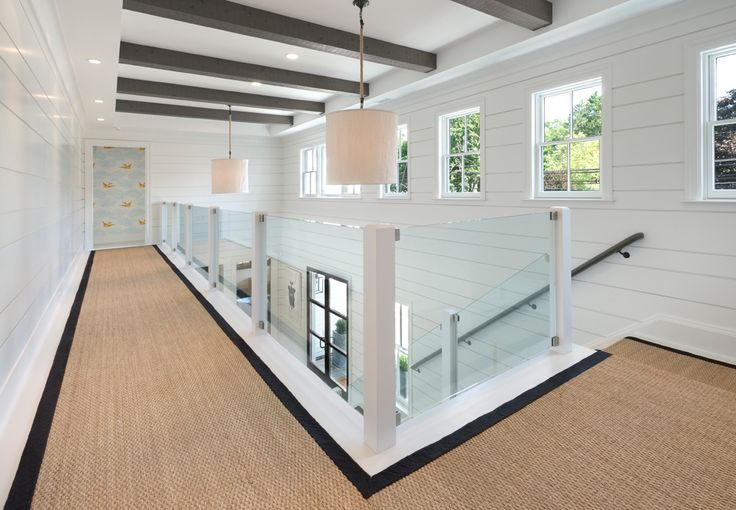 This light-filled center hall opens the whole house. No dark walls here! Modern Urban Farmhouse
