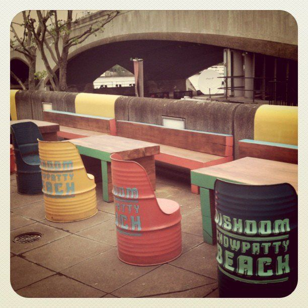 reclaimed railway sleepers and colourful barrels as seating