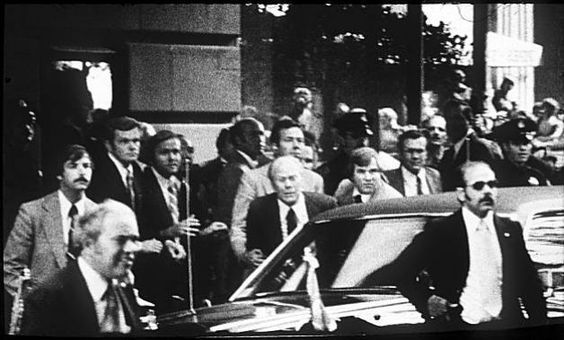 Sept. 22, 1975. Sara Jane Moore attempts to shoot President Ford outside a San Francisco hotel, but misses when a civilian bystander grabs her arm and deflects the shot.