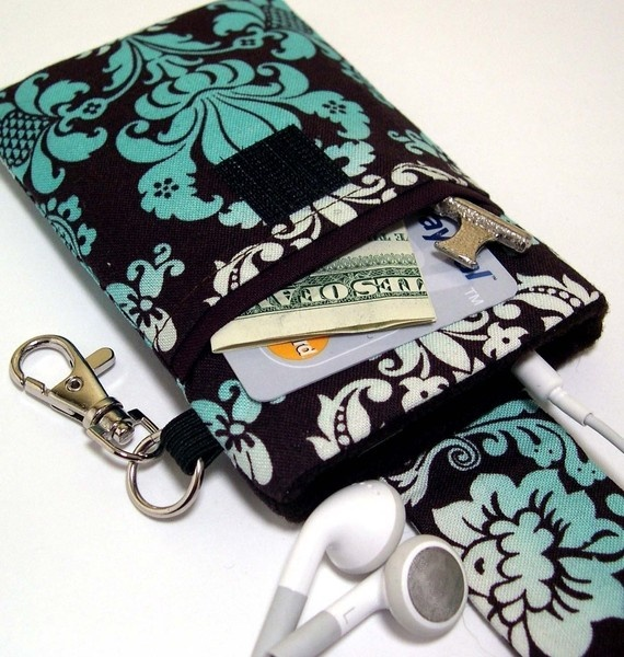 iPhone case with pocket and velcro closing strap...