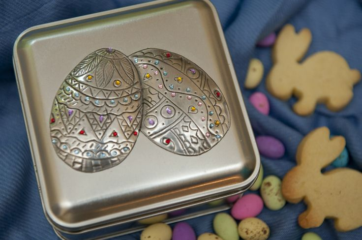 http://annmack.co.za/store/products/easter-special-re-usable-tin-with-pewter-hand-crafted-detail-filled-with-chocs-and-bunnies/