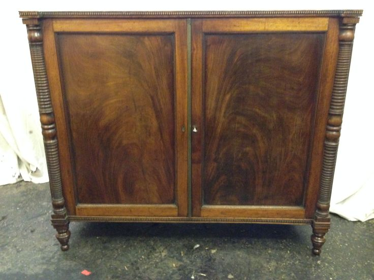 Victorian mahogany sideboard with turned columns to doors and matched pair veneered door panels,