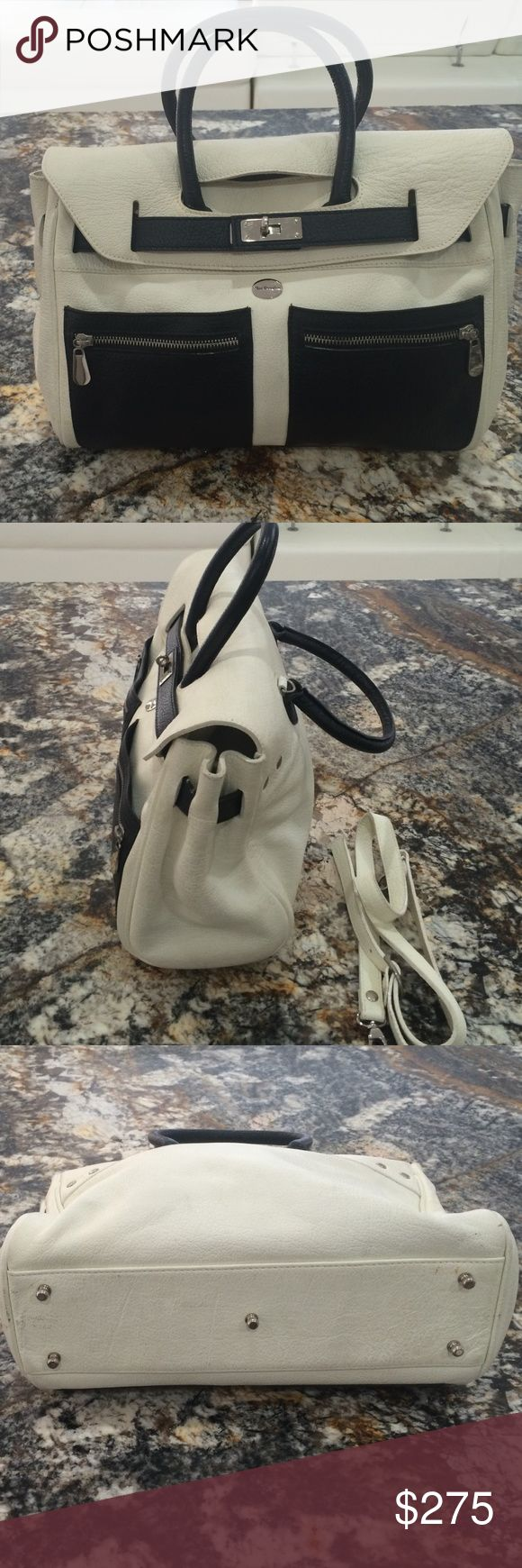 Mac Douglas purse. French luxury brand. Black and white great condition. Bought in Paris. Tag: Louis Vuitton Mac Douglas Bags