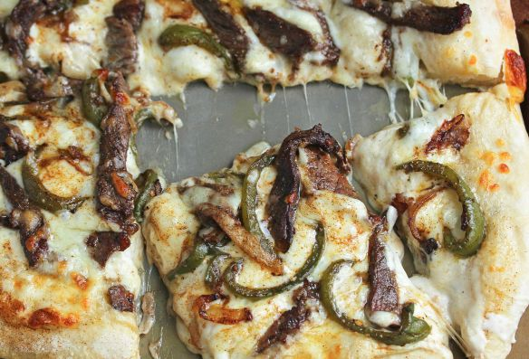Philly Cheese Steak gets a modern twist with Philly Cheese Steak Pizza. Steak, onions, green peppers, provolone cheese on perfect Red Star Yeast crust.