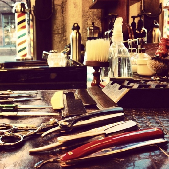 The barber- I am lucky to have all my grandfather's barber razors from his barbershop....'Paddy's Barbershop, Yonkers, NY'.