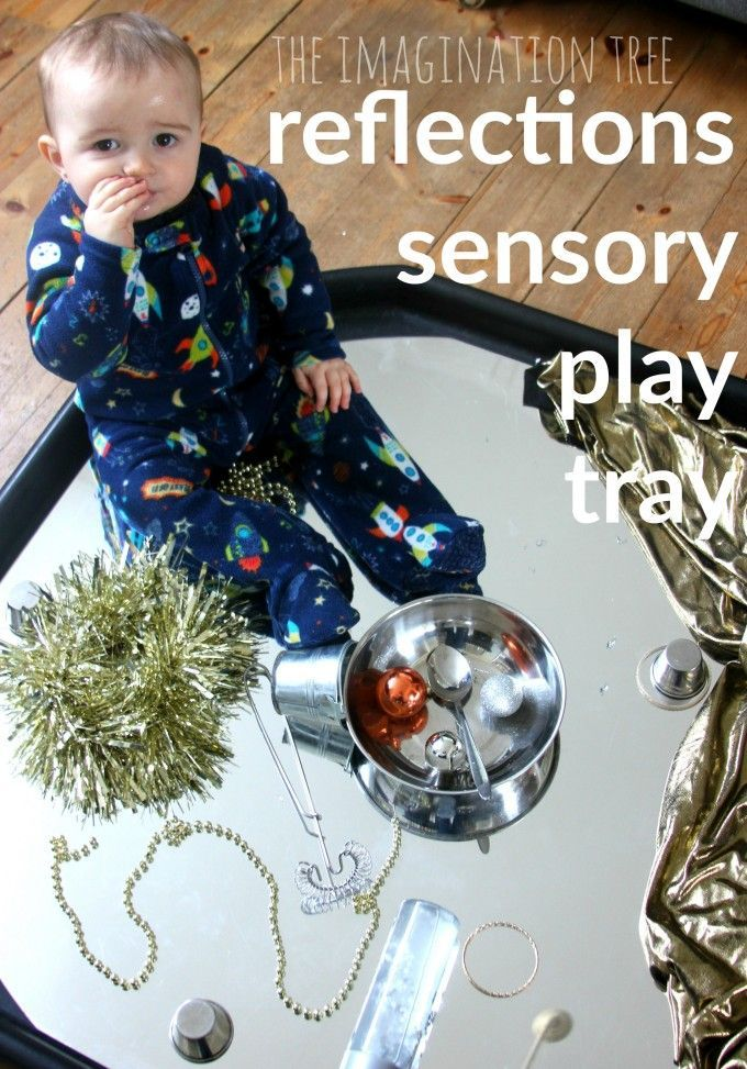 Baby heuristic play tray with reflective and metallic obejcts