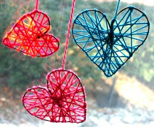DIY yarn hearts to decorate windows for Valentine's Day.