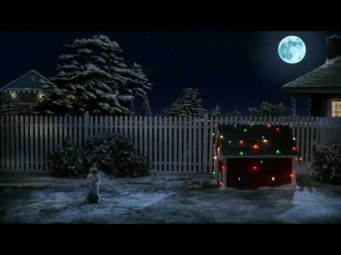 All this cute dog wants for Christmas is a visit by Santa Claus to his dog house...