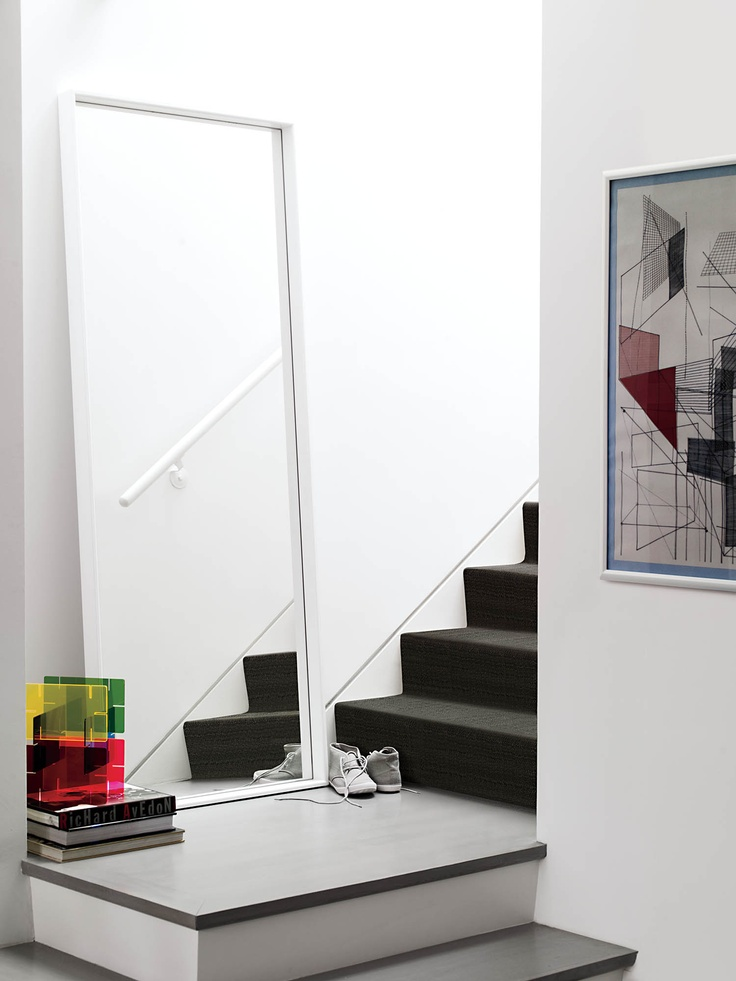 Even your stairway needs a mirror. Luciano Mirror Designed by Luciano Bertoncini