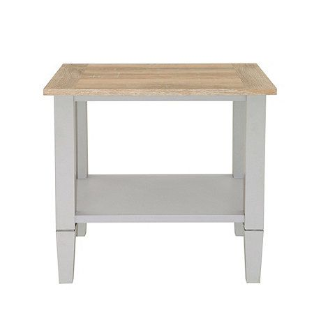 True to its name, our 'Rustic' range has a subtly homespun look which will complement traditional interiors. This side table features a two-tone, pale grey finish with a gently weathered oak effect top, while tapered legs add an elegant finishing touch.