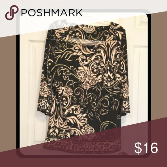 H & M Ladies Top Beautiful and Luxurious Top Black with a cream and metallic gold print 95% POLYESTER 5% SPANDEX  MACHINE WASH AND TUMBLE DRY LOW REMOVE PROMPT  EUC CLEAN AND NON SMOKING HOME H&M Tops Blouses