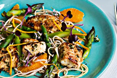 Marinated fish salad with soba noodles, orange and asparagus