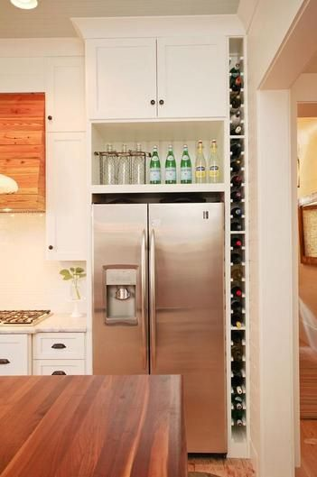 A creative storage solution like this compact wall-length shelf is great for storing bottles in tight spaces.