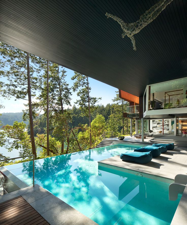 This backyard space has a stunning view. Not to mention its luxurious pool and overall relaxing/vacation feel.