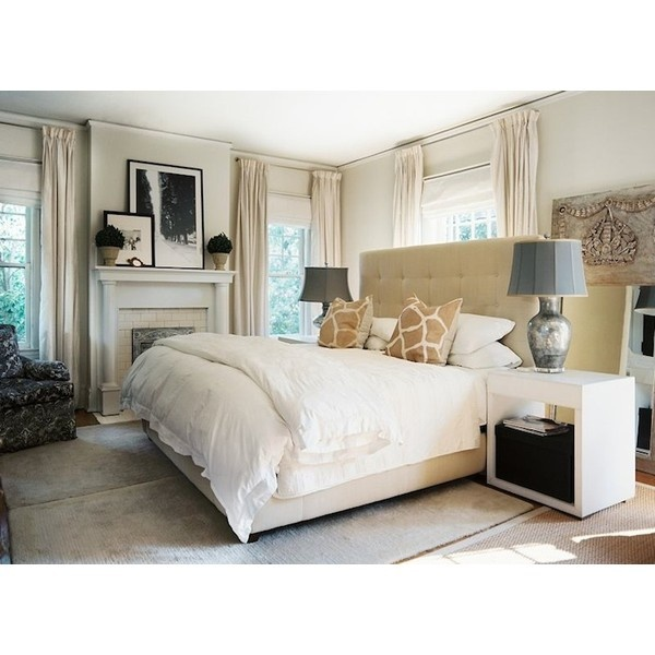 bedrooms - Giraffe Pillow tan walls ivory silk drapes fireplace camel tufted bed headboard ...