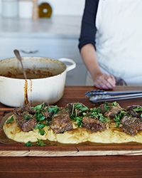 This rich, comforting braise is made by slow-cooking short ribs with apples, smoked porter and coffee. It's delicious with polenta.