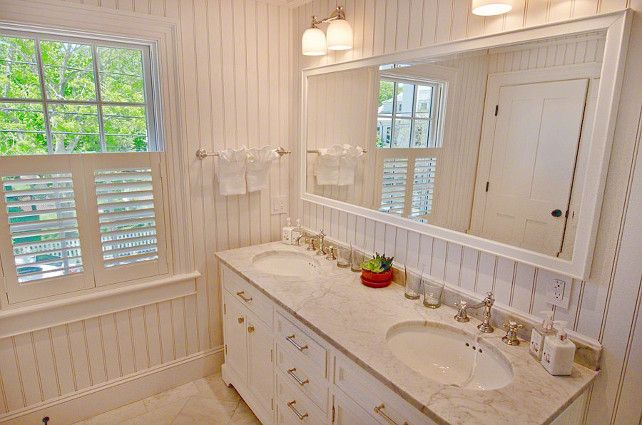 LOVE this for the hall bath...beadboard, white/cream cabinetry, marble, and chrome accents.