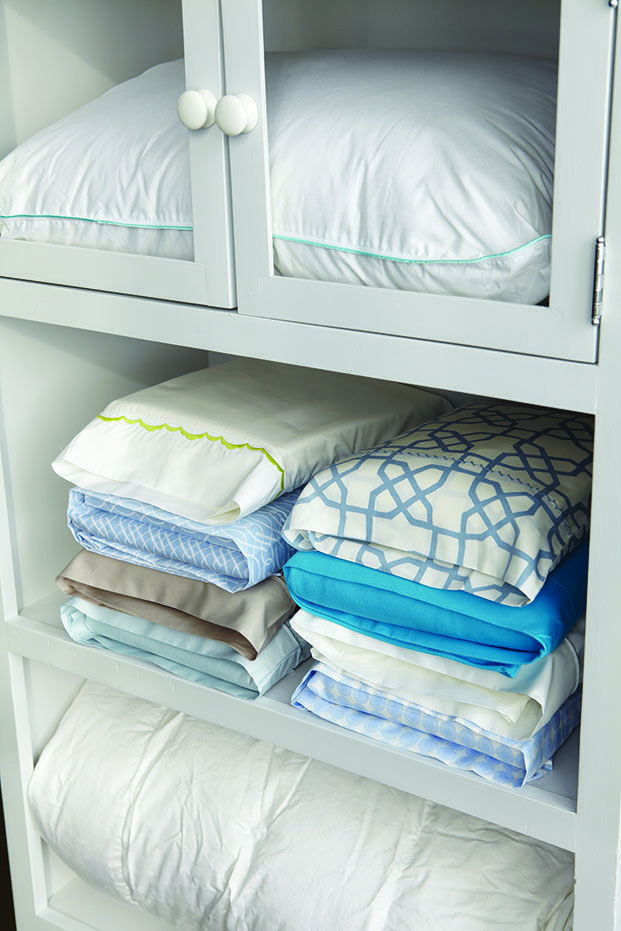 Keep your folded sheets in their respective pillow cases, so it's always easy to grab the whole sheet set at once.