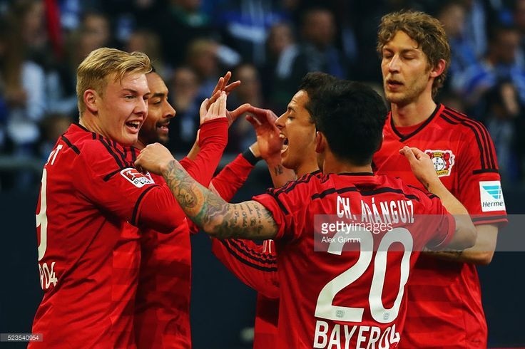 Karim Bellarabi (2L) of Leverkusen celebrates his team's second goal with team mates Julian Brandt, Javier Hernandez, Charles Aranguiz and Stefan Kiessling (L-R) during the Bundesliga match between FC Schalke 04 and Bayer Leverkusen at Veltins-Arena on April 23, 2016 in Gelsenkirchen, Germany.
