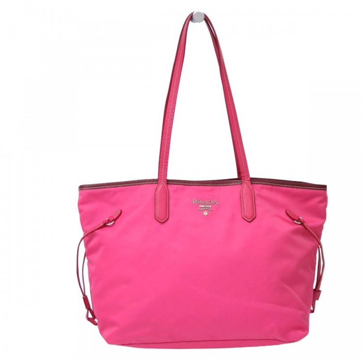 This authentic PRADA Vela Tote Bag is made from pink nylon and leather. The bag opens to a matching interior. Itfeatures saffiano leather trim with double handles. One of those classic PRADA designs the Velais made forcomfort and shopping.  For more items similar to this https://www.swayy.com.au/