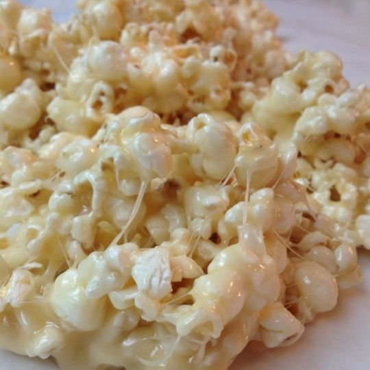 Movie night treat: Marshmallow Caramel Popcorn.    1/2 c. brown sugar 1/2 c. butter 9-10 marshmallows 12 c. popcorn.    Microwave brown sugar and butter for 2 minutes. Add marshmallows.     Microwave until melted, 1 1/2 to 2 minutes. Pour over popcorn. YUMMY!