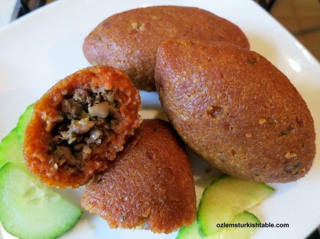 Oruk, baked icli kofte, a version of kibbeh; these bulgur balls with walnut and ground meat stuffing are a real treat.