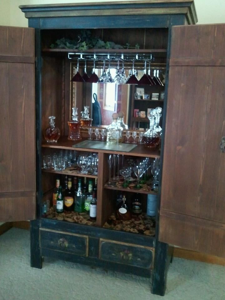 genius way to repurpose an armoire or tv cabinet