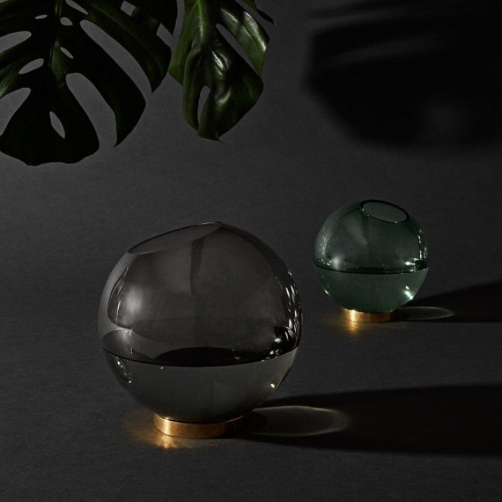 Round glass vase by AYTM. Elegant glass bowl on a brass ring. Use it for flowers, a plant or storage  Material: Glass and brass Size: D 21 x H 20.5 cm  Product info:  Made of a handmade glass. Small variation in colour and shape may occur. Food safe. Dishwasher safe - except the brass lid.