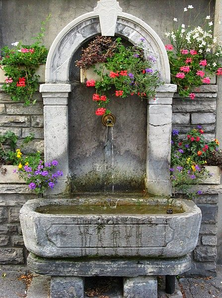 Interlaken, Switzerland  Well with flowers - AgiVega