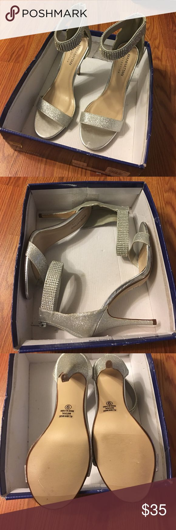 Silver peep toe heels Worn once to a wedding; almost perfect condition; missing two jewels as shown in picture Manhattan Collection Shoes Heels