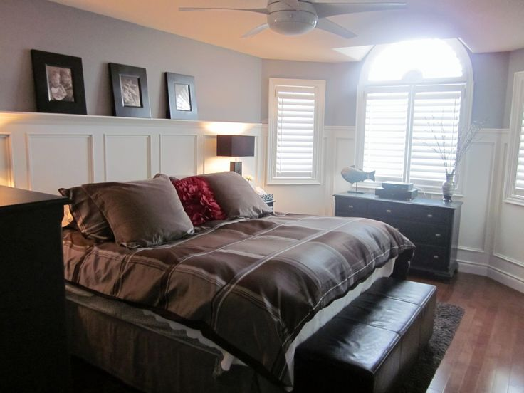 Master bedroom with simple white bed linens an upholstered headboard and gauzy linen drapes Master bedroom bed linens