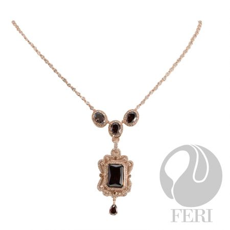 """- Exclusive 950 fine sterling silver - Exclusive 3 micron rose gold plating - Set with AAA white cubic zirconia and a rich mahogany colored cubic zirconia - Length: 16"""" + 4"""" extender with lobster clasp"""